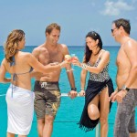 Cruise turquoise waters with a tropical drink in hand!